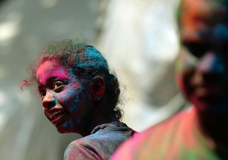 An Indian girl takes part in Holi celebrations in Mumbai on March 13, 2017. Holi, the festival of colours, is a riotous celebration of the coming of spring and falls on the day after full moon annually in March. (Punit Paranjpe/AFP/Getty Images)
