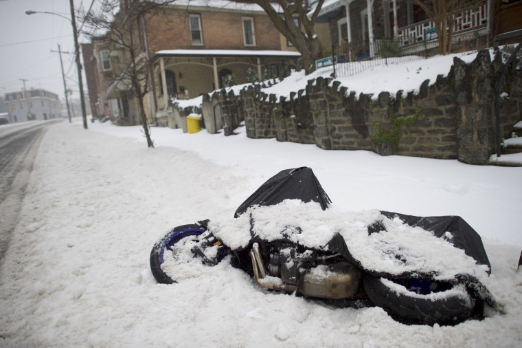 Snow accumulates on top of a fallen motorcycle March 14, 2017 in Philadelphia, Pennsylvania. A blizzard is forecast to bring more than a foot of snow and high winds to up to eight states in the Northeast region, as New York and New Jersey are under a state of emergency. School districts across the entire region were closed and thousands of flights were canceled. (Photo by Mark Makela/Getty Images)