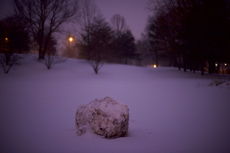 A snowball remaining from the last snowstorm is covered with a fresh coat of snow in Gorgas Park before dawn March 14, 2017 in Philadelphia, Pennsylvania. A blizzard is forecast to bring more than a foot of snow and high winds to up to eight states in the Northeast region, as New York and New Jersey are under a state of emergency. School districts across the entire region were closed and thousands of flights were canceled. (Photo by Mark Makela/Getty Images)