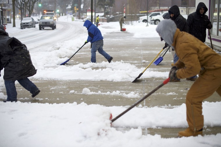 Men shovel a sidewalk March 14, 27, 2017 in the Roxborough area of Philadelphia, Pennsylvania. Much of the Northeast is under a state of emergency as a blizzard is expected to bring over one foot of snow and high winds to the area. (Photo by Mark Makela/Getty Images)