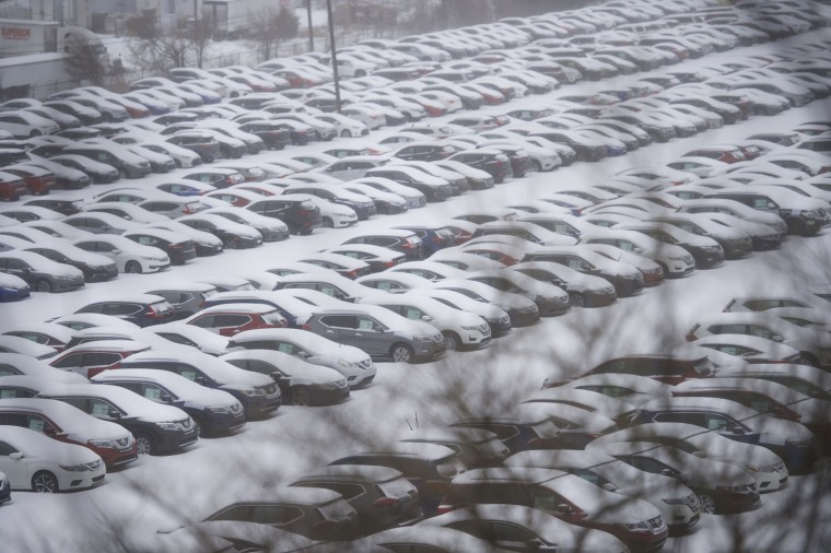 Snow blankets new cars parked in a lot March 14, 2017 in Norristown, Pennsylvania. A blizzard is forecast to bring more than a foot of snow and high winds to up to eight states in the Northeast region, as New York and New Jersey are under a state of emergency. School districts across the entire region were closed and thousands of flights were canceled. (Photo by Mark Makela/Getty Images)