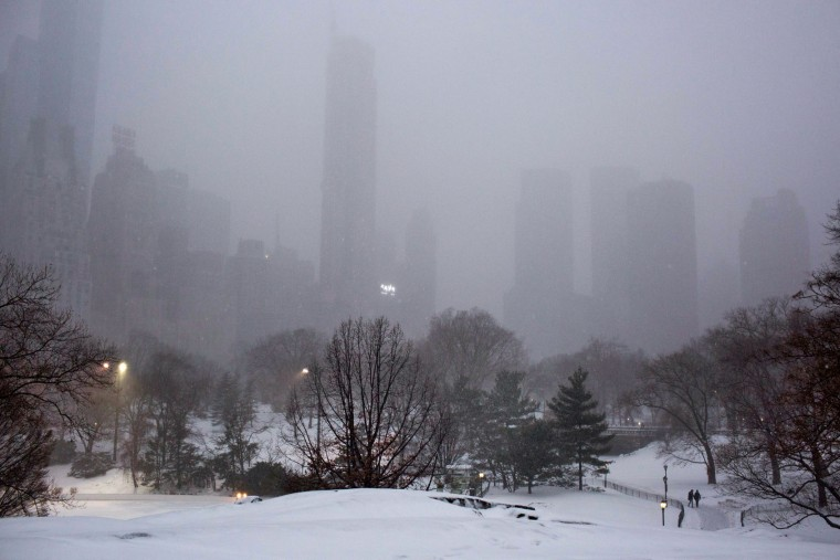 Walkers in the snow in Central Park during a day of heavy snow and freezing rain on March 14, 2017 in New York City. Much of the Northeast is under a state of emergency as a blizzard is expected to bring over one foot of snow and high winds to the area. (Photo by Kevin Hagen/Getty Images)