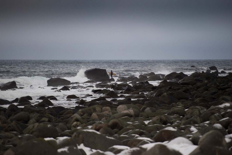 A surfer waits for the right moment to jump into the water in Unstad along the northern Atlantic Ocean on March 12, 2017. (OLIVIER MORIN/AFP/Getty Images)