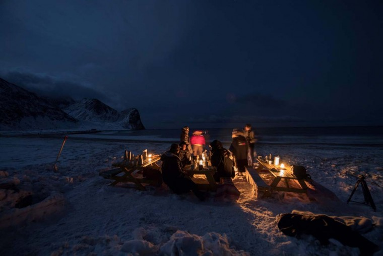 Surfers rest in front of a camp fire after an evening of surfing in Unstad along the northern Atlantic Ocean on March 12, 2017. (OLIVIER MORIN/AFP/Getty Images)