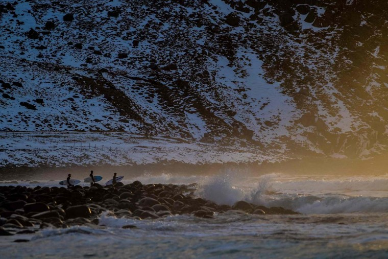 Surfers wait for the right moment to enter the water in Unstad along the northern Atlantic Ocean on March 12, 2017. (OLIVIER MORIN/AFP/Getty Images)