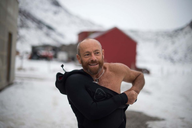 Former Australian surf legend from the 1980s Tom Carroll, 55, walks in the snow as he dons his wetsuit in Unstad, on March 9, 2017. (OLIVIER MORIN/AFP/Getty Images)