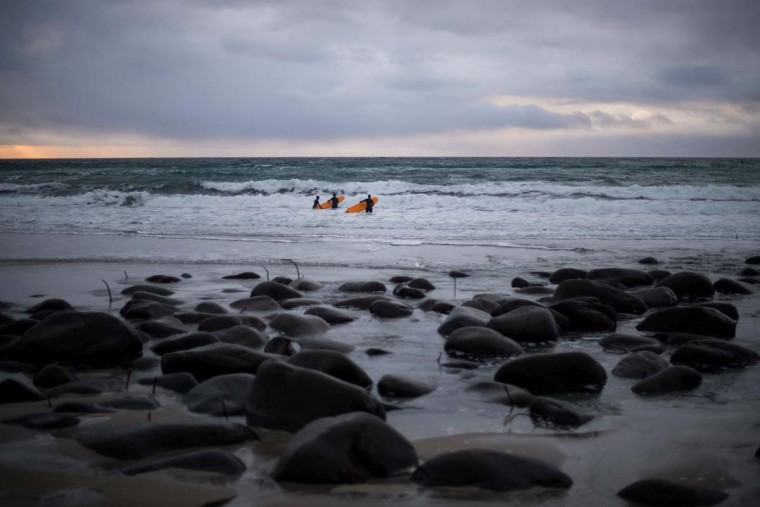 Novice surfers wait for a wave at Unstad along the northern Atlantic Ocean on March 12, 2017. (OLIVIER MORIN/AFP/Getty Images)