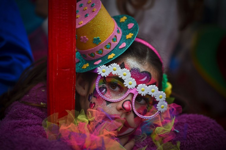 A child dressed as clown takes part on the Carnival Clown's Parade at Sesimbra village on February 27, 2017. (Patricia de Melo Moreira/AFP/Getty Images)