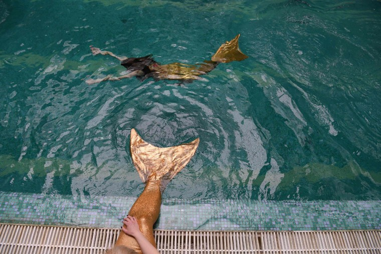 A picture taken on March 16, 2017 shows a woman practicing swimming with a mermaid tail at a mermaid training school in a pool in Moscow. Russian women who have dreamt of becoming a mermaid since their youngest years, start turning their fantasies into reality with a new type of fitness mermaid swimming.(NATALIA KOLESNIKOVA/AFP/Getty Images)