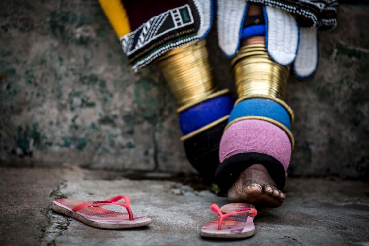 This photo taken on March 6, 2017 at the home of South African artist Esther Mahlangu in Mabhoko Village, Siyabuswa, Mpumalanga, shows the rings and ankle-wear common to Ndebele women. Mahlangu recently opened her exhibition at the Melrose Gallery where her series of artwork inspired by Nelson Mandela was unveiled on March 1. The artist has produced six paintings reproduced from drawings created by Mandela in her signature Ndebele style. The exhibition will include previous work by Mahlangu. (GULSHAN KHAN/AFP/Getty Images)