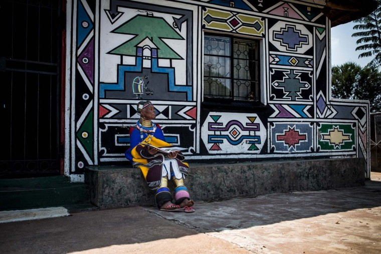 South African artist Esther Mahlangu, 81, poses at her home in Mabhoko Village, Siyabuswa, Mpumalanga on March 6, 2017. Mahlangu recently opened her exhibition at the Melrose Gallery where her series of artwork inspired by Nelson Mandela was unveiled on March 1. The artist has produced six paintings reproduced from drawings created by Mandela in her signature Ndebele style. The exhibition will include previous work by Mahlangu. (GULSHAN KHAN/AFP/Getty Images)