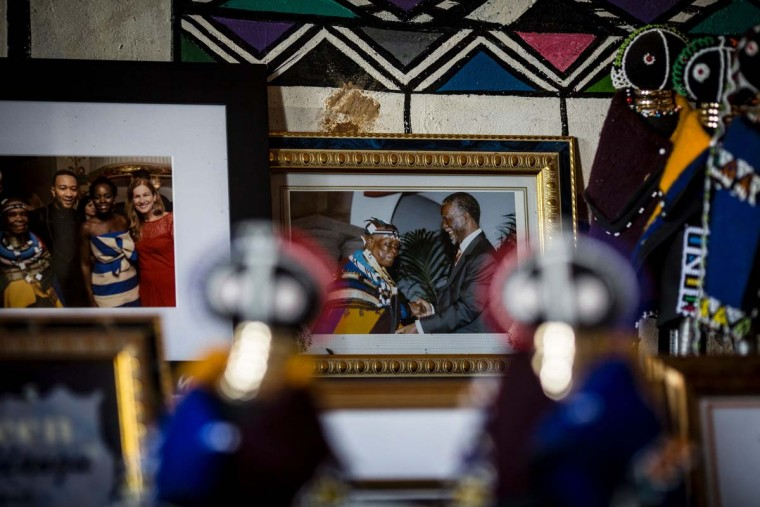 This photo taken on March 6, 2017 at the home of South African artist Esther Mahlangu in Mabhoko Village, Siyabuswa, Mpumalanga, shows a framed photograph of Mahlangu shaking hands with former South African president Thabo Mbeki. Mahlangu recently opened her exhibition at the Melrose Gallery where her series of artwork inspired by Nelson Mandela was unveiled on March 1. The artist has produced six paintings reproduced from drawings created by Mandela in her signature Ndebele style. The exhibition will include previous work by Mahlangu. (GULSHAN KHAN/AFP/Getty Images)