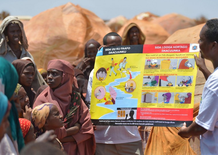 Aid workers use a visual aid to give lessons on sanitation to people living in a makeshift camp for the internally displaced on the outskirts of Baidoa town, the capital of Bay region of south-western Somalia where the spread of cholera has claimed tens of lives of IDP's escaping drought from areas cut-off to emergency aid by al-Shabaab Islamists on March 14, 2017. The United Nations is warning of an unprecedented global crisis with famine already gripping parts of South Sudan and looming over Nigeria, Yemen and Somalia, threatening the lives of 20 million people. For Somalis, the memory of the 2011 famine which left a quarter of a million people dead is still fresh. (Tony Karumba/AFP/Getty Images)