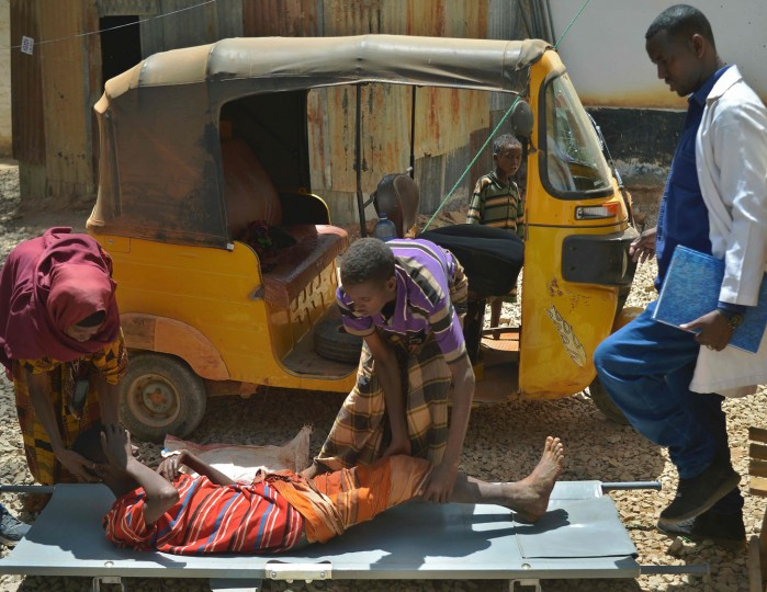 A young boy weakened by cholera is assisted off a tuk-tuk (scooter) onto a stretcher soon after he arrives at the regional hospital in Baidoa town, the capital of Bay region of south-western Somalia where severe cases of malnourishment and cholera are reffered by a UNICEF- funded health programme for children and adults displaced by drought on March 15, 2017. The United Nations is warning of an unprecedented global crisis with famine already gripping parts of South Sudan and looming over Nigeria, Yemen and Somalia, threatening the lives of 20 million people. For Somalis, the memory of the 2011 famine which left a quarter of a million people dead is still fresh. (Tony Karumba/AFP/Getty Images)