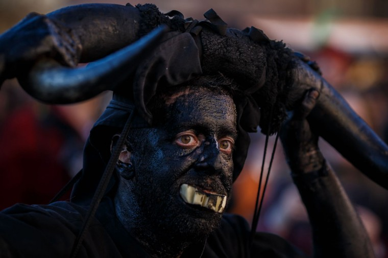 "A man sporting horns on his head and grease on his face to represent ""Diablos de Luzon"" (Luzon's devils) performs during the carnival in Luzon, near Guadalajara, on February 25, 2017.(CESAR MANSO/AFP/Getty Images )"