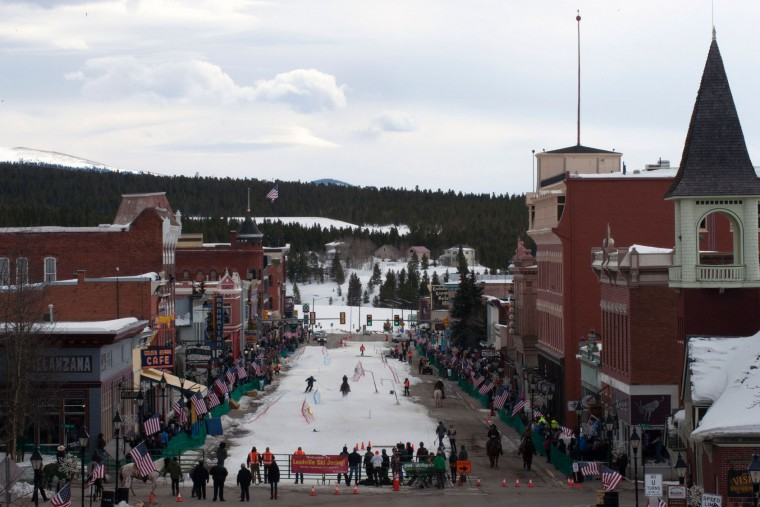 Spectators line the sidewalks of historic Harrison Avenue in Leadville, Colorado to watch the 68th annual Leadville Ski Joring weekend competition on March 5, 2017. Skijoring, which has its origins as a competitive sport in Scandinavia, has been adapted over the years to include a team made up of a rider and skier who must navigate jumps, slalom gates, and the spearing of rings for points. Leadville, with an elevation of 10,152 feet (3,094 m), the highest incorporated city in North America, has been hosting skijoring competitions since 1949. (Jason Connolly/AFP/Getty Images)