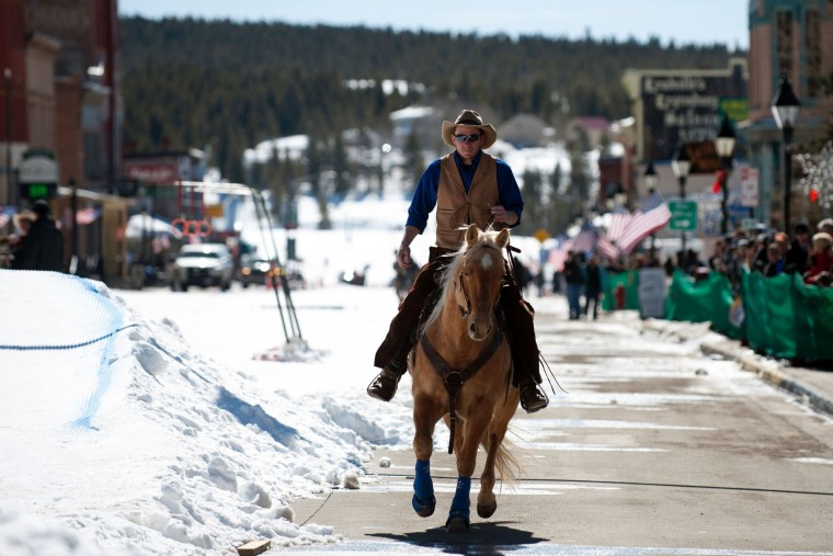Nick Ehlenfeldt of Leadville, Colorado rides his horse Smarty down Harrison Avenue in Leadville, Colorado prior to the start of the 68th annual Leadville Ski Joring weekend competition on Saturday, March 4, 2017 in Leadville, Colorado. Skijoring, which has its origins as a competitive sport in Scandinavia, has been adapted over the years to include a team made up of a rider and skier who must navigate jumps, slalom gates, and the spearing of rings for points. Leadville, with an elevation of 10,152 feet (3,094 m), the highest incorporated city in North America, has been hosting skijoring competitions since 1949. (Jason Connolly/AFP/Getty Images)