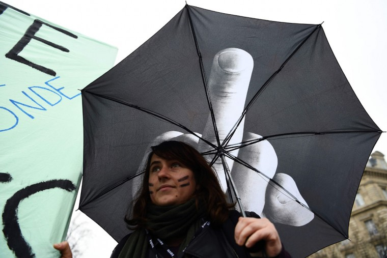 A woman holds an umbrella during a demonstration for the International Women's Day in Paris on March 8, 2017. (GABRIEL BOUYS/AFP/Getty Images)
