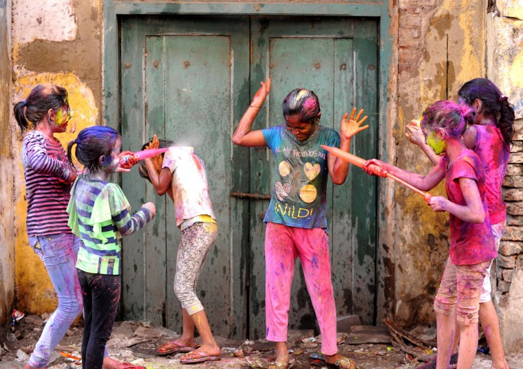 Indian revellers play with colours during Holi celebrations in Chennai on March 13, 2017. The Hindu festival of Holi, or the 'Festival of Colours' heralds the arrival of spring and the end of winter. (Arun Sankar/AFP/Getty Images)