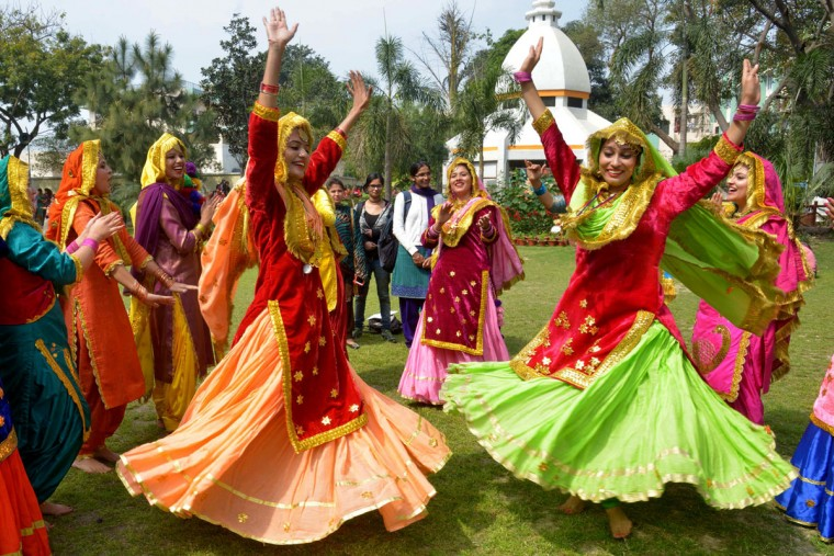 Young Indian women wear traditional Punjabi dress as they perform the 'Giddha' dance during celebrations on the occasion of an International Women's Day function in Amritsar on March 8, 2017. (NARINDER NANU/AFP/Getty Images)