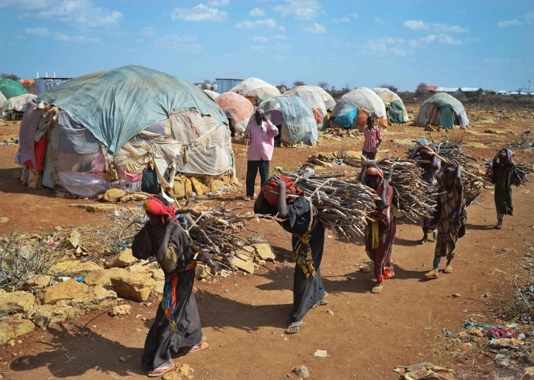 Women carry firewood on March 15, 2017 as they walk back to a makeshift camp on the outskirts of Baidoa, in the southwestern Bay region of Somalia, where thousands of internally displaced people arrive daily after they fleeing the parched countryside. The United Nations is warning of an unprecedented global crisis with famine already gripping parts of South Sudan and looming over Nigeria, Yemen and Somalia, threatening the lives of 20 million people. For Somalis, the memory of the 2011 famine which left a quarter of a million people dead is still fresh. (Tony Karumba/AFP/Getty Images)