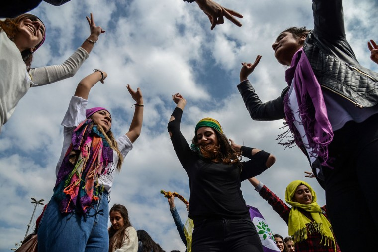 Women flash victory signs during a demonstration as part of International Women's Day on March 8, 2017 in Diyarbakir. (ILYAS AKENGIN/AFP/Getty Images)