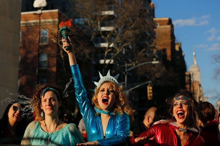 A woman dressed as Statue of Liberty reacts as she takes part during an International Women's Strike Rally in Washington square park on March 8, 2017 in New York City. (KENA BETANCUR/AFP/Getty Images)