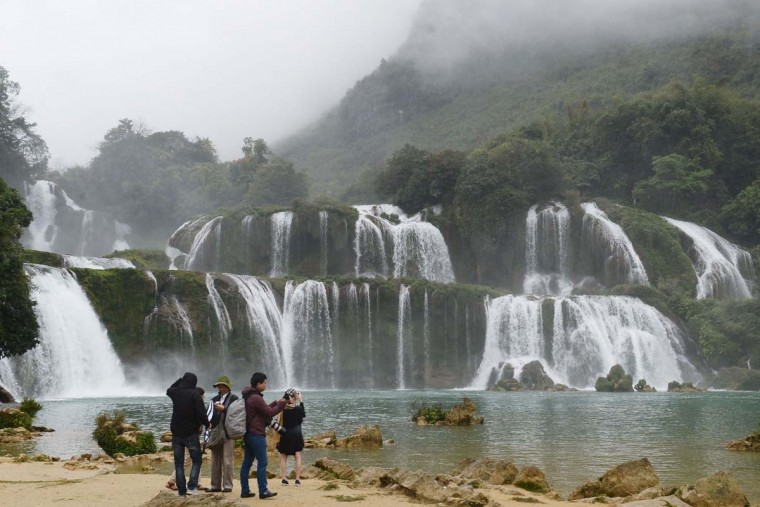 This picture taken on March 12, 2017 shows Vietnamese tourists visiting the Thac Ban Gioc or Ban Gioc falls, located on the Vietnam-China land border area in Trung Khanh district, Vietnam's northern province of Cao Bang. (HOANG DINH NAM/AFP/Getty Images)