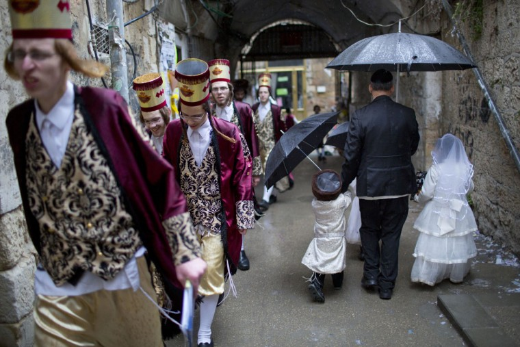 Ultra-Orthodox Jewish men and children wear costumes during the Jewish holiday of Purim in Mea Shearim ultra-Orthodox neighborhood in Jerusalem, Monday, March 13, 2017. The Jewish holiday of Purim celebrates the Jews' salvation from genocide in ancient Persia, as recounted in the Scroll of Esther. (AP Photo/Oded Balilty)