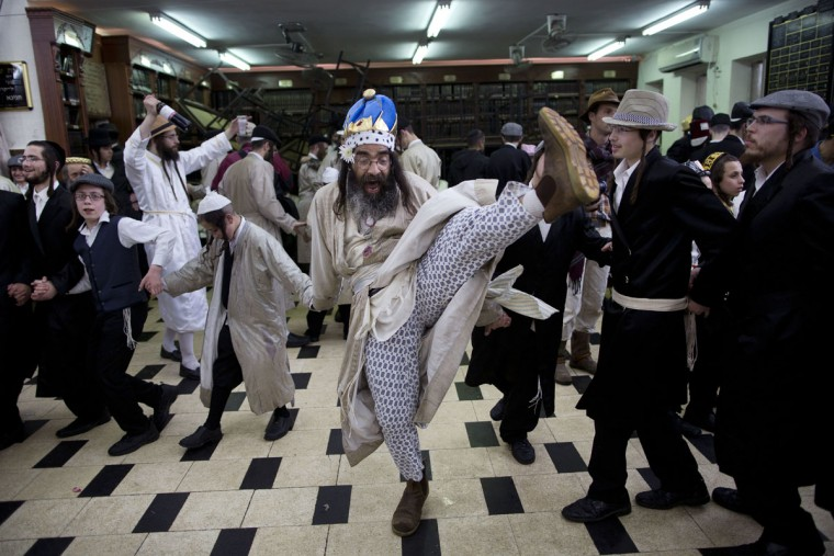 Ultra-Orthodox Jewish men celebrate the Jewish holiday of Purim in Mea Shearim ultra-Orthodox neighborhood in Jerusalem, Monday, March 13, 2017. The Jewish holiday of Purim celebrates the Jews' salvation from genocide in ancient Persia, as recounted in the Scroll of Esther. (AP Photo/Oded Balilty)