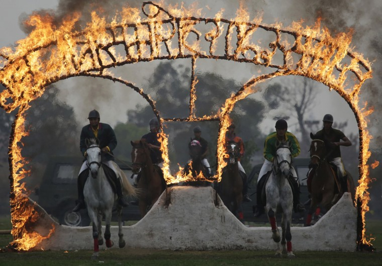 Nepalese army soldiers demonstrate their horse riding skills during the Ghode Jatra festival, an annual horse festival in Kathmandu, Nepal, Monday, March 27, 2017. According to legend, the festival is held to celebrate the victory over a demon named Tundi and people believe that the clamor of horses' hooves during the festival keeps the demon's spirit away. (AP Photo/Niranjan Shrestha)