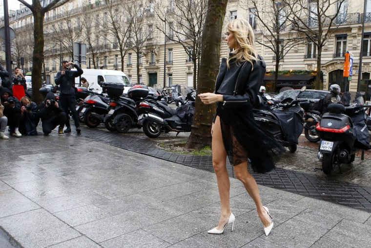 Model Elena Perminova poses outside after the show of Giambattista Valli's Fall-Winter 2017/2018 ready-to-wear fashion collection presented in Paris, Monday March 6, 2017. (AP Photo/Francois Mori)