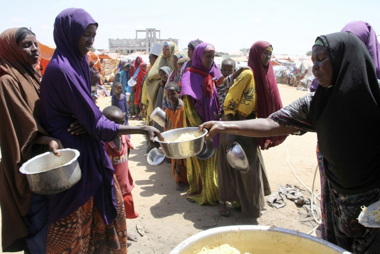 Displaced Somali women stand in a queue to receive food handouts in a camp outside of Mogadishu, Somalia, Monday, March, 27, 2017. Somalia's drought is threatening 3 million lives according to the U.N. and in recent months aid agencies have been scaling up their efforts but say more support is urgently needed to prevent the crisis from worsening. (AP Photo/Farah Abdi Warsameh)