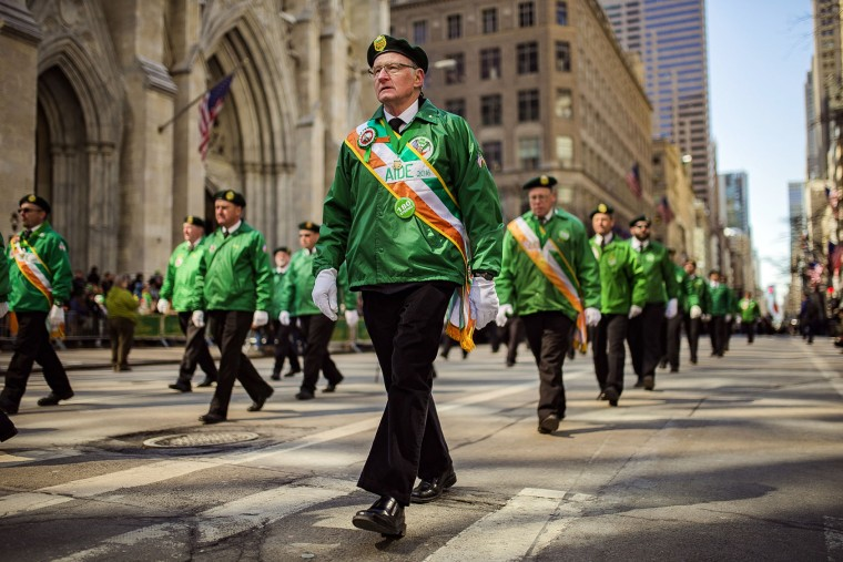 Revelers march up Fifth Avenue during the St. Patrick's Day Parade, Friday, March 17, 2017, in New York. New York City was awash in green and Irish pride as throngs celebrated at the annual St. Patrick's Day Parade in Manhattan. (AP Photo/Andres Kudacki)