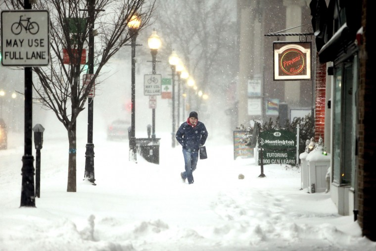 Mike Read of Morristown, N.J., walks down South Street as a Nor'easter blasts N.J. and the Northeast with heavy snow, high winds. The late-winter storm is expected to drop as much as two feet of snow on Morris County, N.J., Tuesday, March 14, 2017. (Bob Karp /The Daily Record via AP)