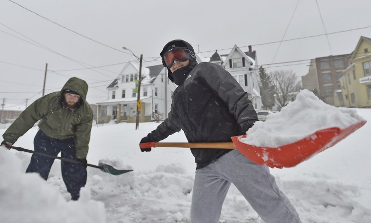 "Bryce Roth, 10, and dad Tommy Roth both shovel snow on their sidewalks on Hanover Ave in Allentown, Pa., on Tuesday, March 14, 2017, as a Nor'easter hit the Lehigh Valley. They were out for about an hour trying to make headway on the falling snow. ""It's crazy, but it doesn't bother me"" Bryce said ""Yeah, I love it"" his dad Tommy said with a sarcastic grin. The heaviest snow in Pennsylvania fell in a swath from the Gettysburg area near the Maryland line in the south, straight north to New York, and northeast to the Pocono Mountains, the Lehigh Valley and the Scranton and Wilkes-Barre region. (April Bartholomew /The Morning Call via AP)"