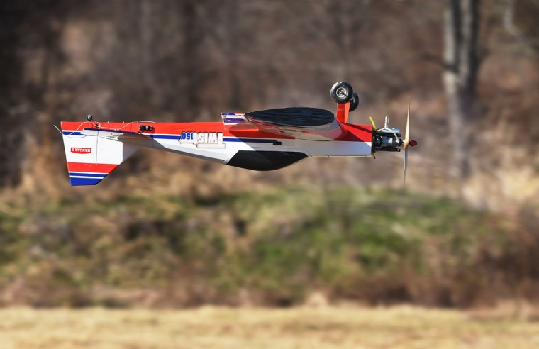 A Hanger 9 Twist 150 model airplane with a 20cc engine is flown up-side-down by Ray Batzer. Members of the Harford County Radio Control Modelers (HCRCM) strive to advance the RC hobby by building and flying scale model airplanes. (Kenneth K. Lam/Baltimore Sun)