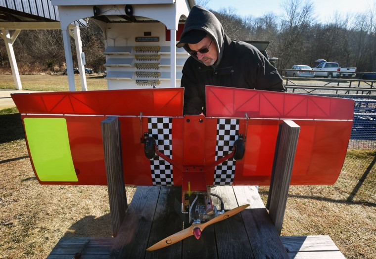 Ray Batzer, of Aberdeen, who has been flying model airplane for over 25 years, attaches the wing to his Twist 150 plane. (Kenneth K. Lam/Baltimore Sun)
