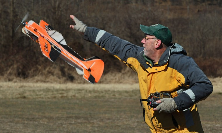 Drew Wilkerson launches a foam radio controlled electric plane. (Kenneth K. Lam/Baltimore Sun)