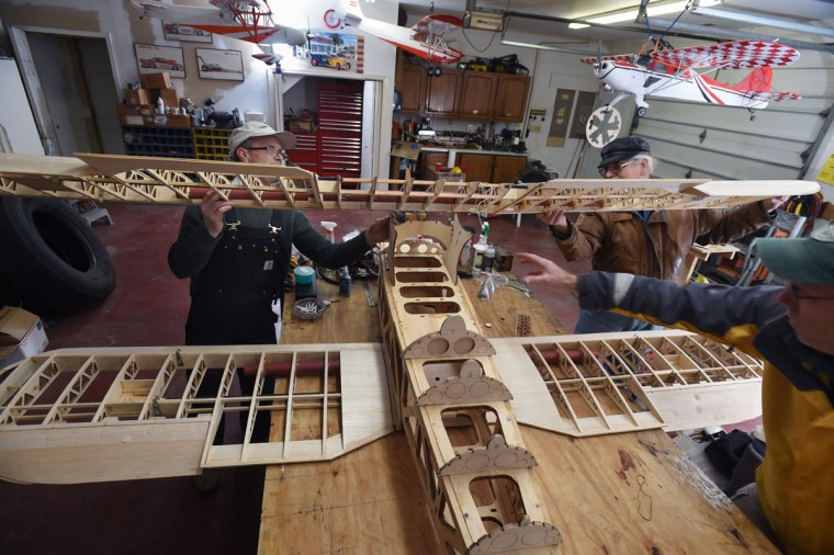 Arthur Pearce, of Bel Air, left, works on building a 1/3 scale YMF Waco model plane with help from fellow members of the Harford County Radio Control Modelers (HCRCM.) (Kenneth K. Lam/Baltimore Sun)