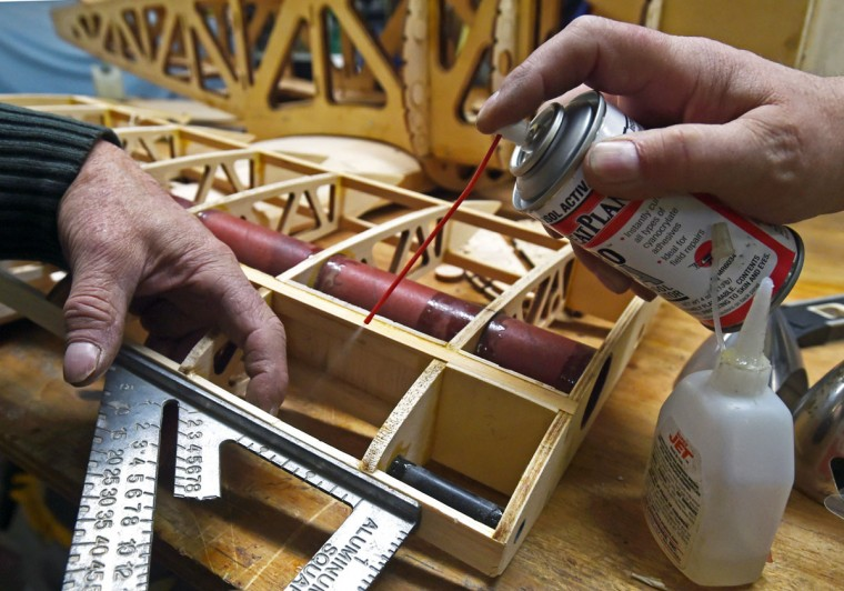 Broken pieces of part of the balsa wood plane's wing being repaired. (Kenneth K. Lam/Baltimore Sun)