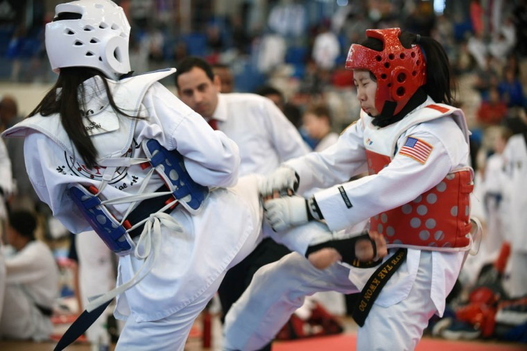 Allison Merced-Aviles, left, 16, of Gaithersburg, scores a hit on My-Hoa Do, 16, of Hanover, Pa., during sparring contest. Over 500 competed in the First Maryland Governor's Cup Taekwondo Championship hosted by the Maryland State Taekwondo Association at the APGFCU Arena Harford Community College. Competitors, ages from 3 to over 60 and from as far as Maine, competed in forms, board breaking and sparring in a full day of contests. All proceeds from the championship will be donated to the Children's Cancer Foundation CCF). (Kenneth K. Lam/The Baltimore Sun)