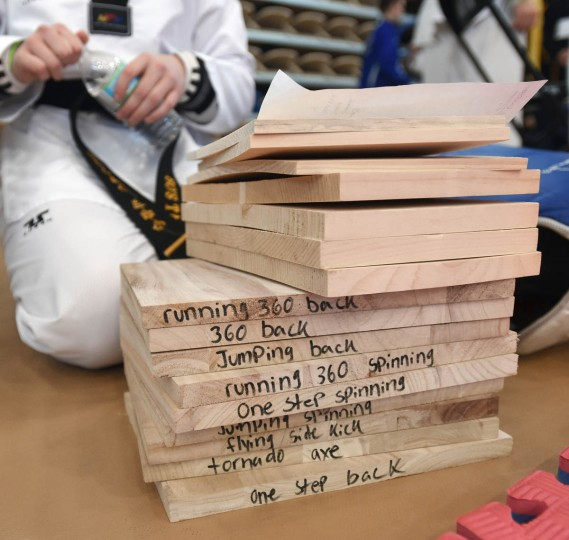 Pine boards with written instruction on how they are to be hold for a breaking compition. Over 500 competed in the First Maryland Governor's Cup Taekwondo Championship hosted by the Maryland State Taekwondo Association at the APGFCU Arena Harford Community College. Competitors, ages from 3 to over 60 and from as far as Maine, competed in forms, board breaking and sparring in a full day of contests. All proceeds from the championship will be donated to the Children's Cancer Foundation (CCF). (Kenneth K. Lam/The Baltimore Sun)