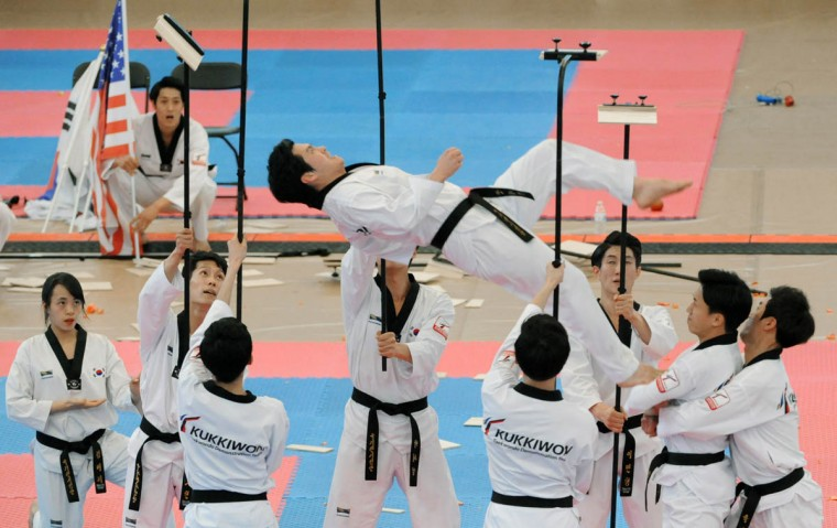 Members of Korean Taekwondo demonstration team Kukkiwon perform. Over 500 competed in the First Maryland Governor's Cup Taekwondo Championship hosted by the Maryland State Taekwondo Association at the APGFCU Arena Harford Community College. Competitors, ages from 3 to over 60 and from as far as Maine, competed in forms, board breaking and sparring in a full day of contests. All proceeds from the championship will be donated to the Children's Cancer Foundation (CCF). (Kenneth K. Lam/The Baltimore Sun)
