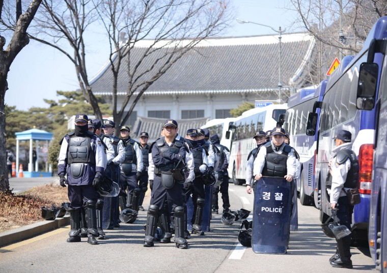 Police gather near the presidential Blue House on March 10, 2017 in Seoul, South Korea. South Korean President Park Geun-hye was ousted as the country's head of state on Friday after the constitutional court upheld a motion to impeach the scandal-ridden leader. (Liu Yun/Xinhua/Zuma Press/TNS)