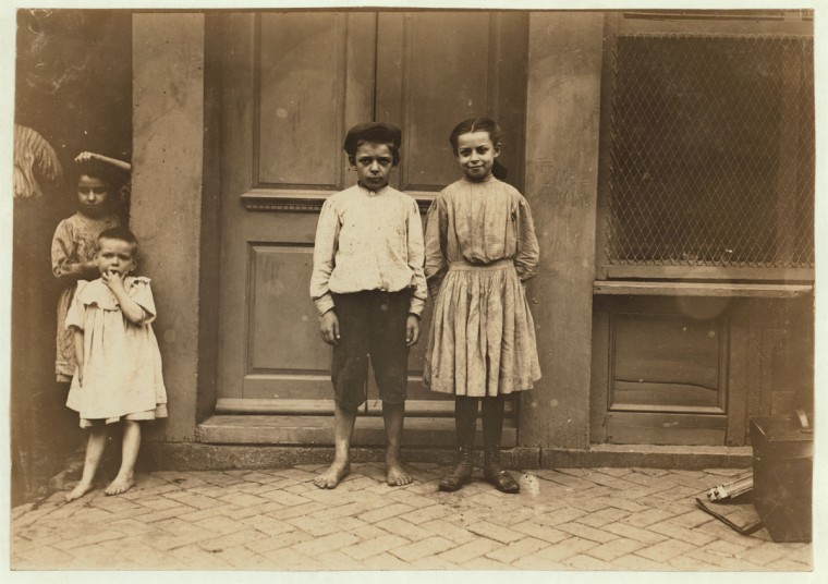 Marie and Albert Kawalski. 615 S. Band St., Baltimore, Md. Albert is 10 and Marie 11 years old. They worked, with mother, last winter, shucking oysters for Varn & Beard Packing Co., Young Island, S.C. (near Charleston). Mrs. Kawalski did not have things represented to her correctly and she found that all the children that had fare paid were compelled to work for the company. Other smaller children worked some and went to school some. Maire and Albert have worked several summers in the berry, beans and tomato fields packing houses near Baltimore. (see my report, July 10, for further [particulars]). Location: Baltimore, Maryland. 1909 July. (Lewis Hine/Photo courtesy LOC)