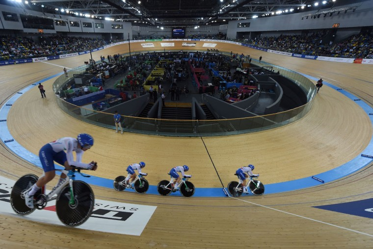 Members of the Italy team compete during the final of the women's team pursuit event at the Hong Kong Velodrome during the Track Cycling World Championships in Hong Kong on April 13, 2017. (Anthony Wallace/AFP/Getty Images)