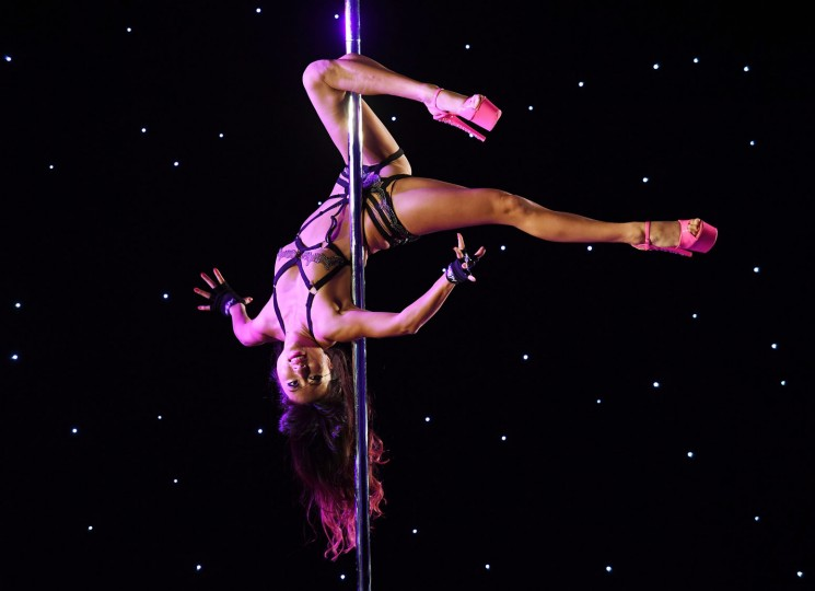 Cherry competes in the 'Exotic' performance category during the 2017 Pacific Pole Championships at the Convention Center in Los Angeles, California on April 9, 2017. Combining dance and acrobatics, originally began as entertainment in strip clubs, pole dancing soon became mainstream as a form of exercise and expression. Competitions are now held in countries throughout the world and has a participant level estimated at over 30,000 in the US. (Mark Ralston/AFP/Getty Images)