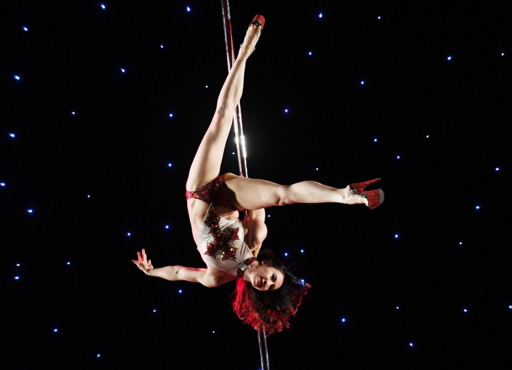Tina Casper competes in the 'Exotic' performance category during the 2017 Pacific Pole Championships at the Convention Center in Los Angeles, California on April 9, 2017. Combining dance and acrobatics, originally began as entertainment in strip clubs, pole dancing soon became mainstream as a form of exercise and expression. Competitions are now held in countries throughout the world and has a participant level estimated at over 30,000 in the US. (Mark Ralston/AFP/Getty Images)