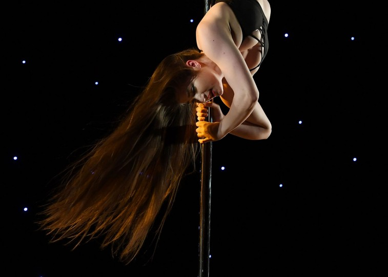 Katrina Anderson competes in the 'Exotic' performance category during the 2017 Pacific Pole Championships at the Convention Center in Los Angeles, California on April 9, 2017. Combining dance and acrobatics, originally began as entertainment in strip clubs, pole dancing soon became mainstream as a form of exercise and expression. Competitions are now held in countries throughout the world and has a participant level estimated at over 30,000 in the US. (Mark Ralston/AFP/Getty Images)